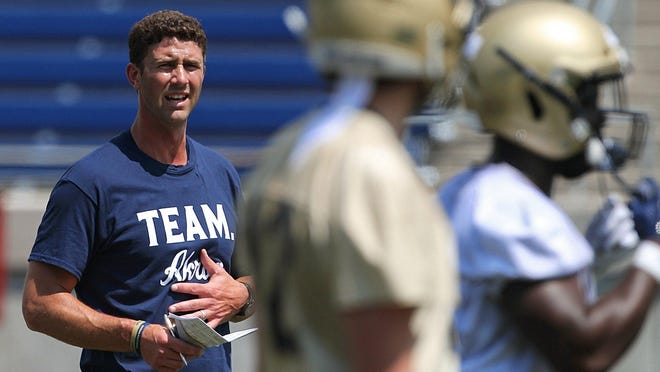 Akron coach Tom Arth wat5ches his team during practice at InfoCision Stadium in August.