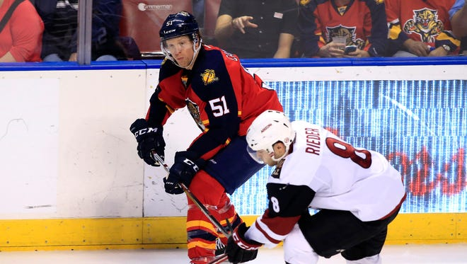 Feb 25, 2016: Florida Panthers defenseman Brian Campbell (51) passes the puck as Arizona Coyotes center Tobias Rieder (8) defends in the third period at BB&T Center. The Panthers won 3-2.