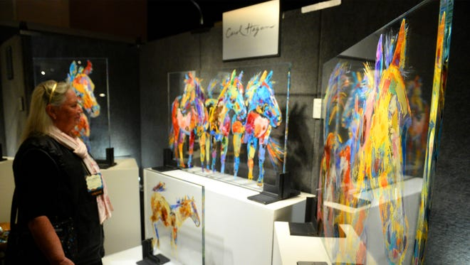 Carol Hagan's oil on glass paintings are a new look at the Russell Skull Society of Artist show in the Civic Auditorium on Thursday.