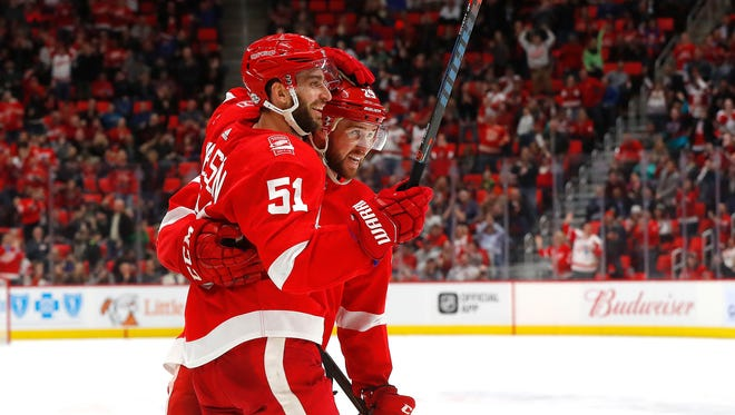 Frans Nielsen (51) celebrates his goal against the Ducks with Mike Green in the second period Tuesday.