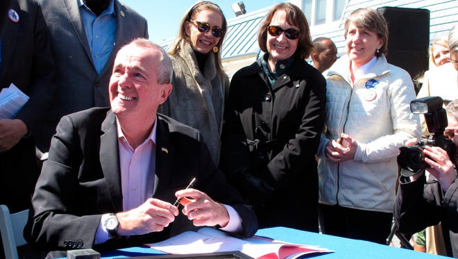 New Jersey Gov. Phil Murphy signs a bill on the boardwalk in Point Pleasant Beach that bans offshore oil and gas drilling in New Jersey's state waters.