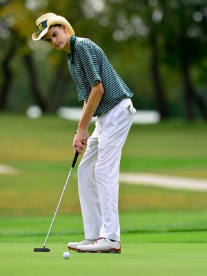 York Catholics' Jon Giambalvo finished one stroke behind teammate Andrew Forjan on Thursday, helping the Fighting Irish to the York-Adams League Division III title. John A. Pavoncello - jpavoncello@yorkdispatch.com