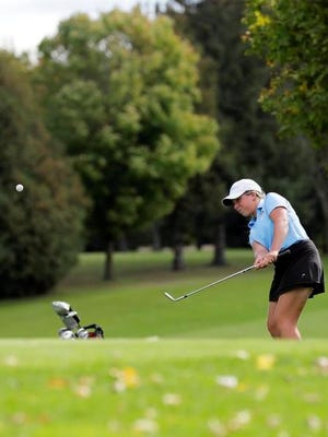 Bay Port's Jo Baranczyk chips onto the green at a WIAA regional girls golf meet at Brown County Golf Course on Wednesday.