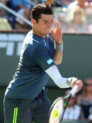 Milos Raonic, of Canada, serves against Rafael Nadal during the men's quarterfinals at the BNP Paribas Open on Friday.