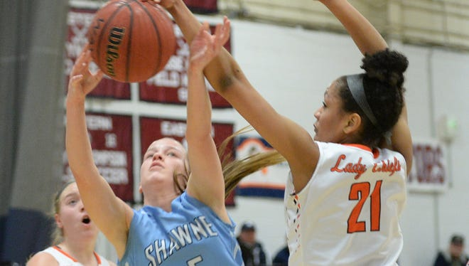 Cherokee's Kennedy Wilburn blocks a shot attempt by Shawnee's Cameron Morgan during Sunday's SJIBT final at Eastern High School. The Chiefs successfully defended their title with a 44-33 victory.