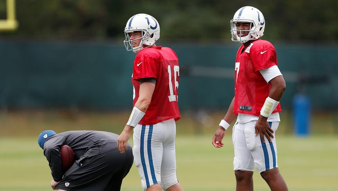 Indianapolis Colts quarterback Scott Tolzien (16) and Jacoby Brissett (7) split time with the number 1 team back on the practice field Wednesday. Sept. 13, 2017. The Colts are preparing to host the Arizona Cardinals this Sunday at Luca Oil Stadium.