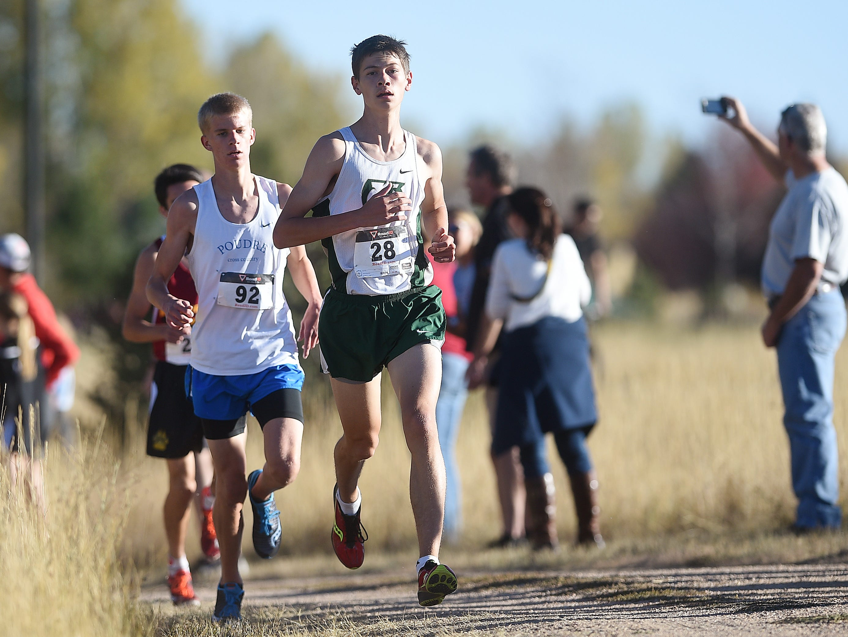 Poudre High School's Bryce Pietenpol, left, and Fossil Ridge High School's Dylan Ko run in the regional cross country meet at Spring Canyon Park on Friday, October 21, 2016.