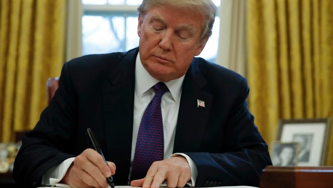 President Trump signs    new tariffs on imported solar panels and washing machines on Jan. 23, 2018.