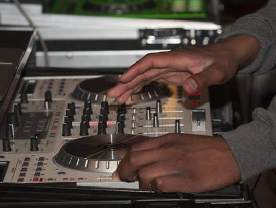 Nick Tyson, DJ Nick, shows his skills on the turntables