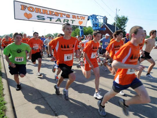 Runners take off from the starting line of Forrest'€™s
