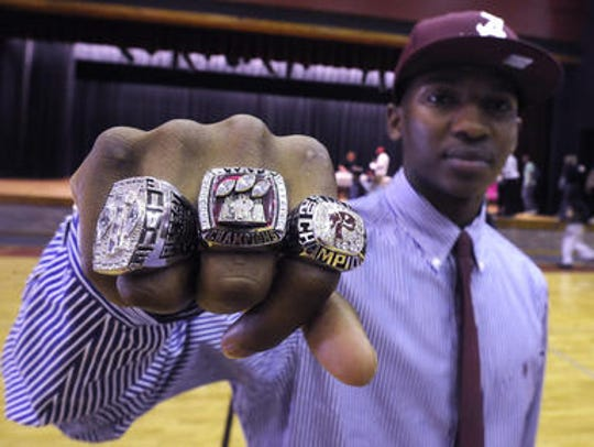 Nick Perry shows off his Prattville High state championship