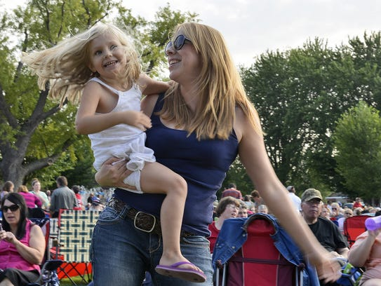 Leanne Loy of St. Cloud dances with her daughter, Amelia.