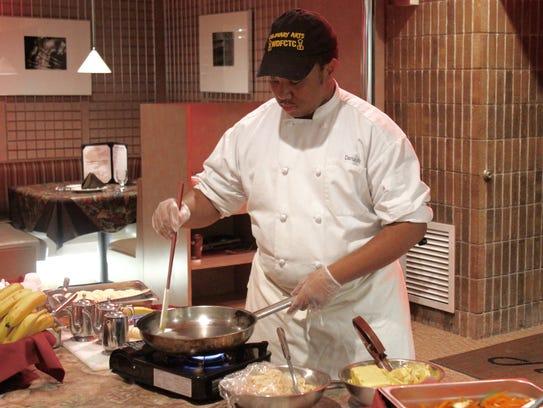 Darius Williams, culinary arts student, prepares bananas