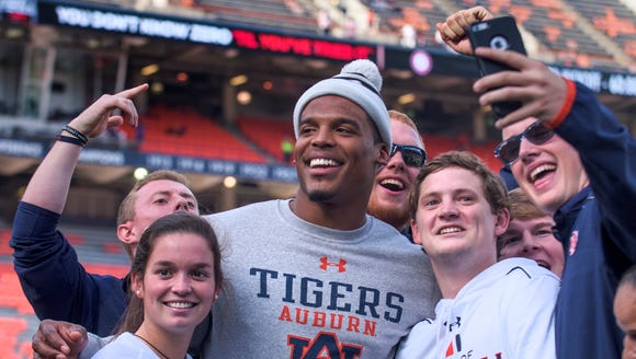 Cam Newton poses in selfies before the Iron Bowl at