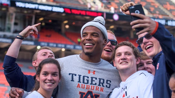 Cam Newton poses in selfies before the Iron Bowl at Jordan-Hare Stadium in Auburn, Ala. on Saturday November 28, 2015. (Mickey Welsh / Montgomery Advertiser)