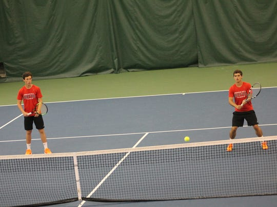 Indian Hill's doubles tandem of Christiano Lima and Pablo Guzman guard the net at Camargo.