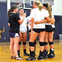 New Dickson County volleyball coach, Sara Davis, takes advantage of a time out during the Lady Cougars scrimmage with McEwen.