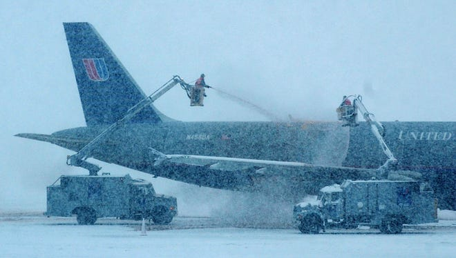 An airplane is de-iced at the Greater Rochester International Airport.