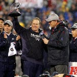 Jan 18, 2015; Foxborough, MA, USA; New England Patriots head coach Bill Belichick celebrates with the Lamar Kraft Trophy while being interviewed by CBS announcer Jim Nantz after the New England Patriots beat the Indianapolis Colts in the AFC Championship Game at Gillette Stadium. Mandatory Credit: Stew Milne-USA TODAY Sports