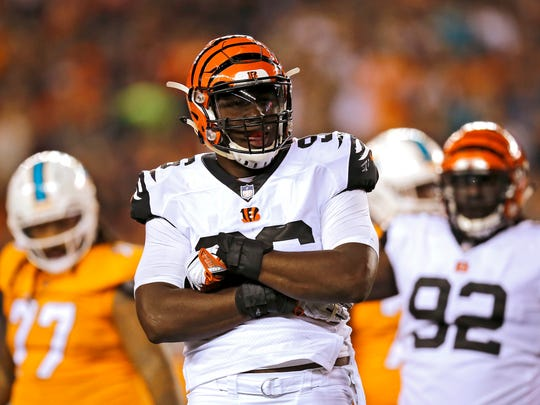 Cincinnati Bengals defensive end Carlos Dunlap (96) celebrates a sack in the third quarter of the NFL Week 4 game between the Cincinnati Bengals and the Miami Dolphins at Paul Brown Stadium on Thursday, Sept. 29, 2016. The Bengals improved to 2-2 with a 22-7 win over the Dolphins.