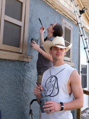 Top 10 Volunteer Airman 1st Class Nicko Hucal helps out at the first We Care Team house painting project of 2018.