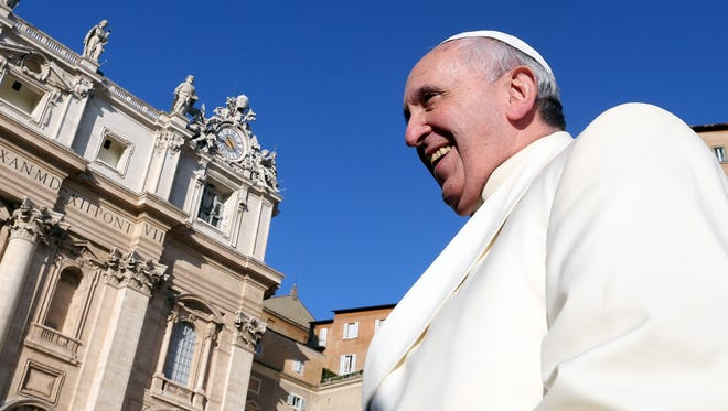 Pope Francis arrives in St. Peter's Square for his weekly audience on Dec. 17.