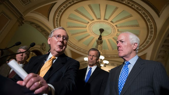 Senate Majority Leader Mitch McConnell of Ky., second from left, joined by, from left, Sen. Roy Blunt, R-Mo., Sen. John Thune, R-S.D.,, and Senate Majority Whip John Cornyn of Texas, faces reporters on Capitol Hill in Washington, Tuesday, June 28, 2016.