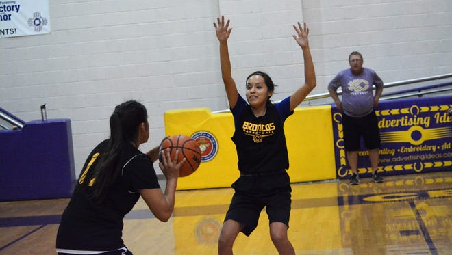 Haile Gleason, right, quickly closes in on Candace Patterson on the perimeter during Kirtland Central's defensive pressing drills at practice on Nov. 9.