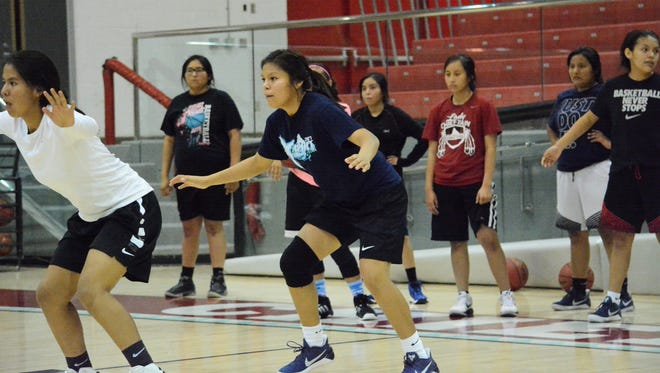 Shiprock's Tia Woods, in black, works on foot speed drills during practice on Nov. 10. The senior forward is back in the rotation after missing the team's state title run last year with a torn right ACL.