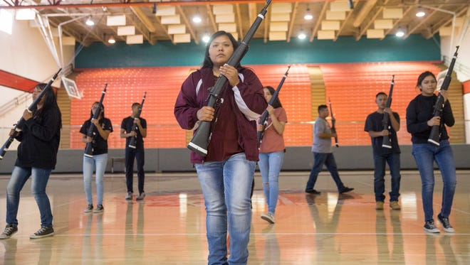 Members of Shiprock's Marine Corps Junior ROTC Armed Drill Team perform on Monday in the Chieftain Pit at Shiprock High School.