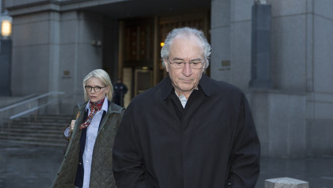 Michelle Pfeiffer as Ruth Madoff and Robert De Niro as Bernard Madoff leave court in the motion picture 'Wizard Of Lies.'
