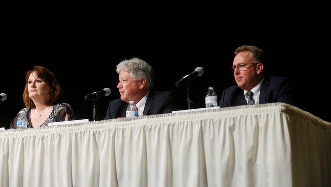 Probate Judge candidates Stacy Biel, left, Gary Risley and Brandt Thrower participate in a candidates forum Wednesday at the Farmington Civic Center.