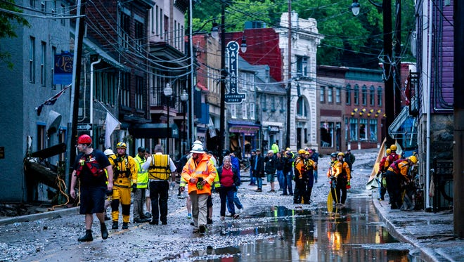 Rescue personnel examine damage on Main Street after a flash flood rushed through the historic town of Ellicott City, Md. on May 27, 2018. The National Weather Service stated as much as 9.5 inches of rain fell in the area.