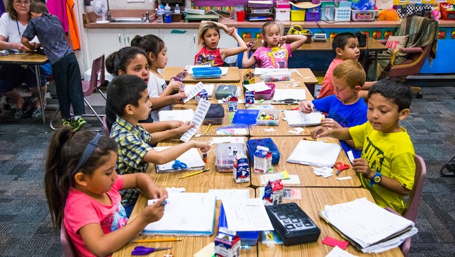 "Jefferson Elementary School in Mesa was recently designated an ""A+ School of Excellence."" Students work in their first-grade class on April 21, 2017."