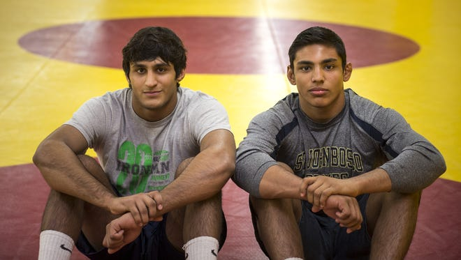 Brothers Anthony Valencia, left, and Zahid Valencia are part of ASU wrestling's No. 1-ranked recruiting class.
