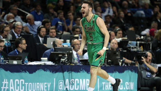 Mar 10, 2017; Brooklyn, NY, USA; Notre Dame Fighting Irish guard Matt Farrell (5) reacts after hitting a three point shot against the Florida State Seminoles during the first half of an ACC Conference Tournament game at Barclays Center. Mandatory Credit: Brad Penner-USA TODAY Sports