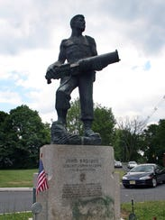 A statue of John Basilone stands at the west end of Somerset Street in Raritan Borough.