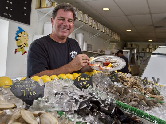 Ken Degnan, co-owner of Runners Seafood Restaurant in Lavallette, prepares a platter of  shrimp, clams and oysters.
