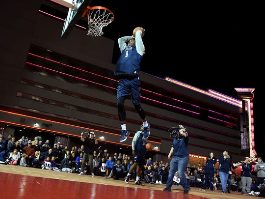 A Wolf Pack player attempts a dunk during Nevada's Arch Madness.
