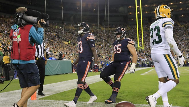 Green Bay Packers cornerback Damarious Randall (23) walks away from Chicago Bears receiver Kendall Wright (13) as Wright celebrates a touchdown in the second quarter on Thursday, Sept. 28, 2017 at Lambeau Field.