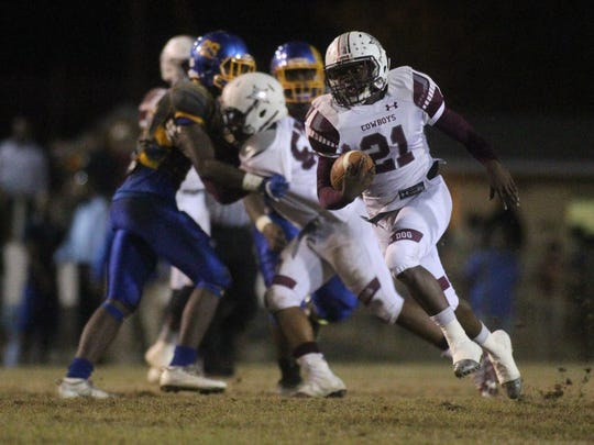 Madison County running back Vinsonta Allen rumbles