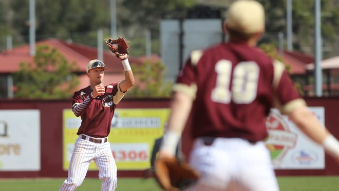 ULM's Nathan Reynolds catches a pop up on the infield.