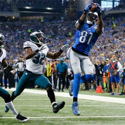 Detroit Lions wide receiver Calvin Johnson catches a 25-yard pass for a touchdown as Eric Rowe (32) and Walter Thurmond try to cover him Thursday.