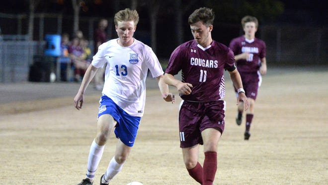 Lee High's Thomas Otteni (13) and Stuarts Draft's Jacob Quick (11) battle for the ball during Friday's Shenandoah District match.
