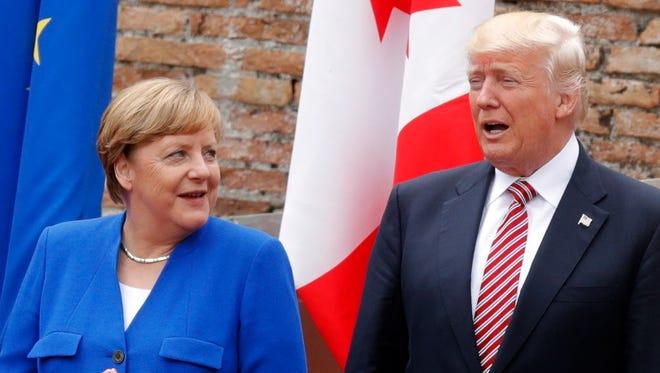 German Chancellor Angela Merkel and President Trump in Taormina, Sicily on May 26, 2017.