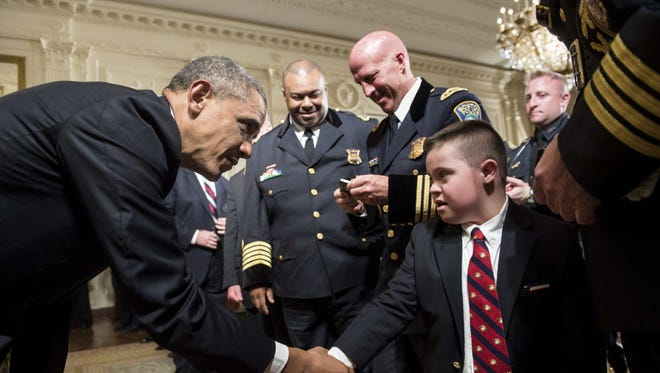 President Obama shakes the hand of Brayden Gero, whose father is Boston Police Officer Jarrod Gero.