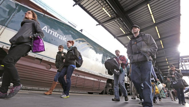 Amtrak passengers arrive in Seattle on the day before Thanksgiving.