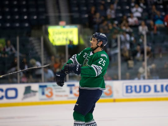 Everblades' John McCarron (25) throws his hockey stick in disappointment after having one of his near goals waived off during the first period of Game 2 of the Kelly Cup Playoffs, South Division semifinals at Germain Arena Friday, April 14, 2017 in Estero, Fla.