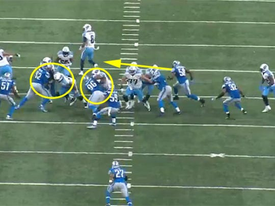 Lions linebacker Thurston Armbrister is able to stop DeMarco Murray for a short gain.