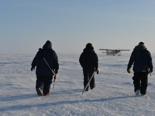 ICE CAMP SKATE, Alaska (March 5, 2018) Members from University of Alaska Fairbanks and Navy's Arctic Submarine Laboratory, walk to an aircraft at Ice Camp Skate during Ice Exercise (ICEX) 2018. ICEX is a five-week exercise that allows the U.S. Navy to assess its operational readiness in the Arctic, increase experience in the region, advance understanding of the Arctic environment, and continue to develop relationships with other services, allies and partner organizations.